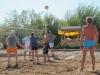 Волейбол. Очень жарко было играть, после каждого сета пили много и обливались.