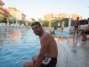 Это тоже турист из Стамбула, мы с ним часто в водное поло играли. Немного по-английски говорит, приехал с женой и детьми.