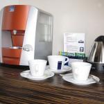 Кофемашина)))) Можно пить вкуснейший кофе вдоволь.